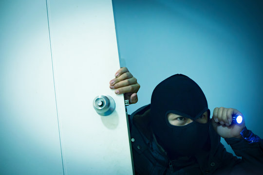 Thief Wearing Mask While Entering House