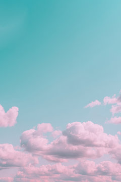 Aesthetic beautiful turquoise sky with pink clouds and empty space. Minimal creative concept of angel paradise