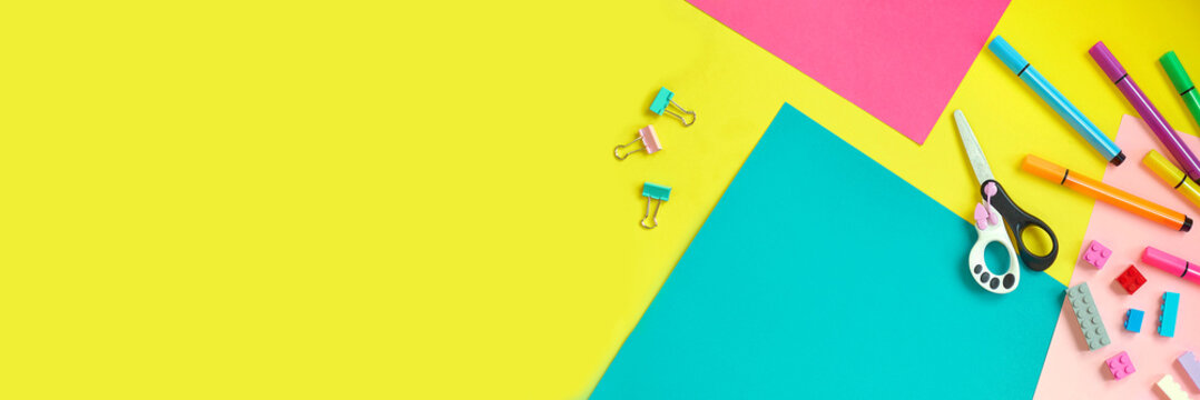 School supplies, stationery on yellow background - space for caption. Child ready to draw with pencils and make application of colored paper. Top view.