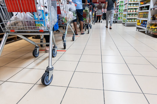 People embracing the new normal with social distancing in checking out at supermarket