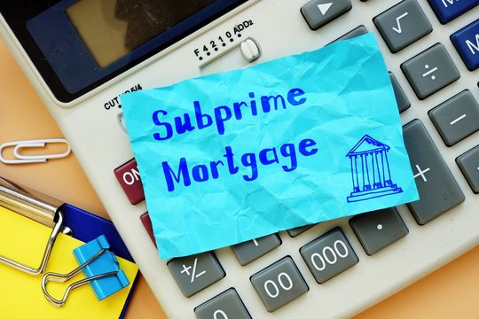 Business concept about Subprime Mortgage with sign on the page.