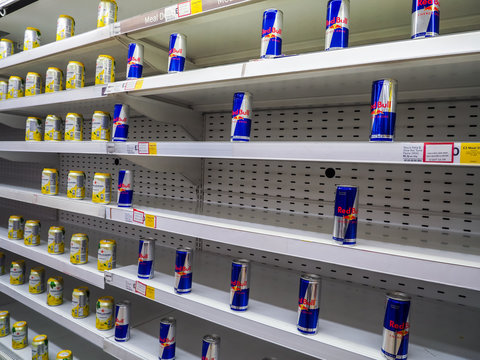 London, Bishopgate, UK. April 24th 2020: Tesco Bishopgate branch, showing low stocks of canned drinks on shelves. Cans of drinks space far apart. London lockdown. Food & drink shortage.