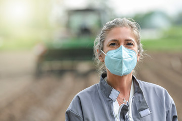Portrait of a woman worker wearing her protective mask