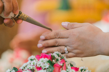 Cropped Image Of Woman With Hands Clasped During Wedding Ceremony