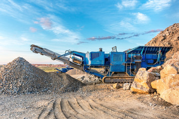 Stone crushing machine in a quarry or outdoor mine