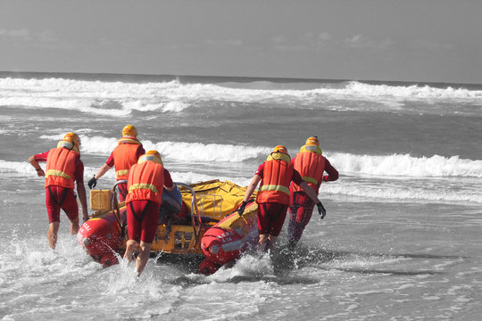 rescue crew launching inflatable boat