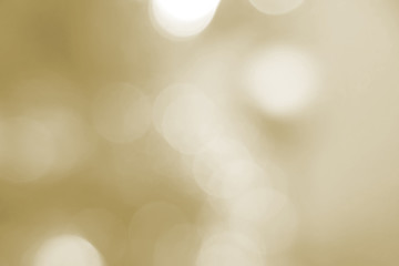 Beautiful autumn and holiday background. Sunlight ochre, gold bokeh close-up. Yellow texture. A...
