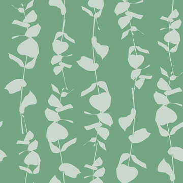 Seamless green pattern with silhouettes of eucalyptus
