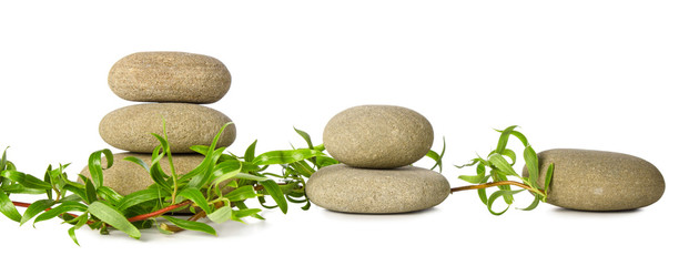 Zen grey stones group and green bamboo horizontal escape isolated on white background