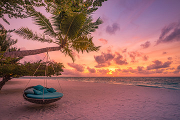 Fototapete - Tropical beach sunset as summer landscape with luxury resort beach swing or hammock and white sand and calm sea for sunset beach landscape. Tranquil beach scenery vacation and summer holiday concept.