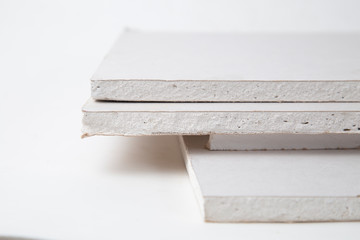 Drywall on a white background. Construction material for repairs.