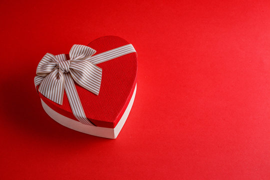 High Angle View Of Heart Shape Gift Box On Red Background