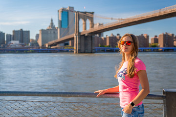 Wall Mural - Beautiful girl standing by the Hudson river in New York city.