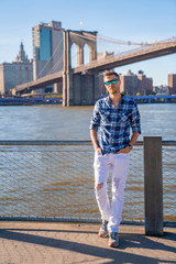 Wall Mural - Young guy standing by the Hudson river in New York city.