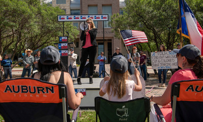 """Supporters of a group called """"Open Texas"""" rally to re-open Texas businesses shut down by the coronavirus pandemic in Frisco, Texas"""