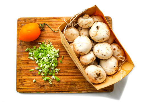 champignons, tomato and chopped greens on a cutting board, isolate on a white background, ready to cook, picture for the menu and recipe