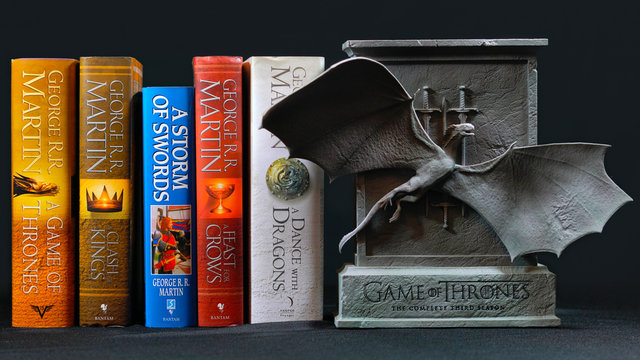 Popular fantasy hardcover books, A Song of Ice and Fire, by George R R Martin, with Game of Thrones special edition dragon cover DVD collection, ADELAIDE, SOUTH AUSTRALIA - JULY 12, 2017.