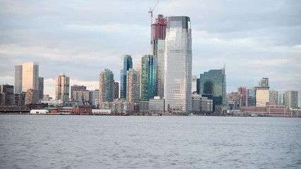 Wall Mural - Modern skyline of Jersey City from a moving boat on the Hudson River