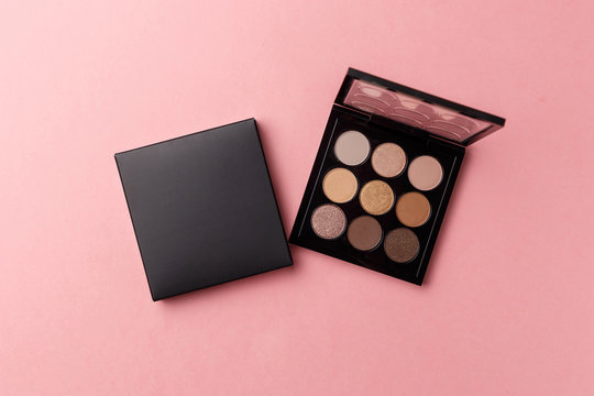 Mua and girly concept. Eyeshadow palette on pink background, eye shadows cosmetics product as luxury beauty brand promotion. Fashion blog design. Contouring palette. Makeup palette close up