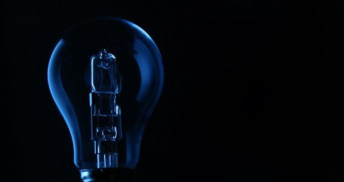 Close-up Of Light Bulb Against Black Background