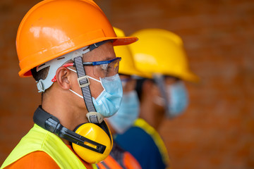 Technician wear protective face masks safety for Coronavirus Disease 2019 (COVID-19) in machine...