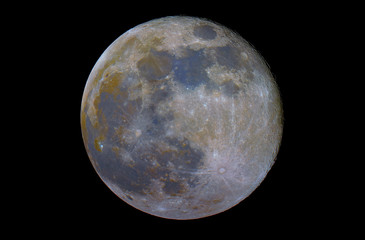 Full mineral super Moon phase, isolated in the black space, with its natural colors, from red to blue.