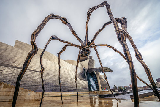 Bilbao, Spain - January 27, 2019: Maman sculpture by Louise Bourgeois in front of Guggenheim Museum in Bilbao city in province of Biscay