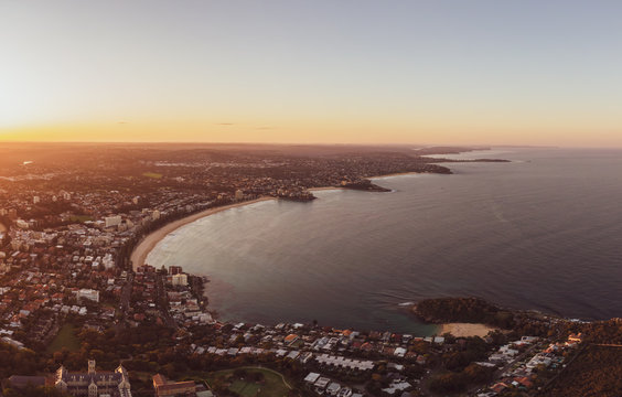 Panoramic aerial drone evening view of the Northern Beaches, a suburb of Sydney, New South Wales, Australia. Left to right: Manly, Freshwater, Curl Curl, Dee Why, Long Reef & Collaroy beaches.