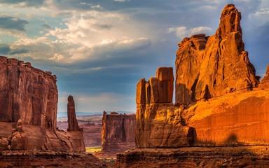 Fototapeta Rock Formations On Cliff Against Cloudy Sky obraz