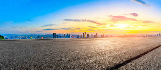 Foto auf AluDibond Lachs Empty asphalt road and Chongqing city skyline and buildings at sunset,China.