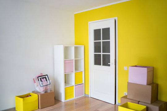 new room. moving to apartment. yellow nursery