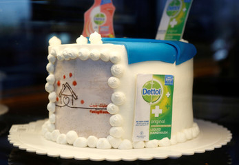 A cake with figures of Dettol bottles and different shapes related to the coronavirus is displayed at a cake shop during the outbreak of the coronavirus disease (COVID-19), in the holy city of Najaf