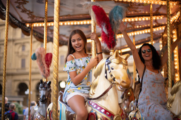 Celebration of happy days at the fair with merry go round