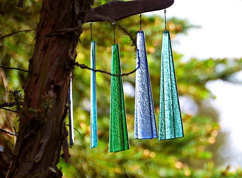 Multi Colored Wind Chimes Hanging From Tree