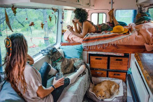 Couple relaxing in their camper van