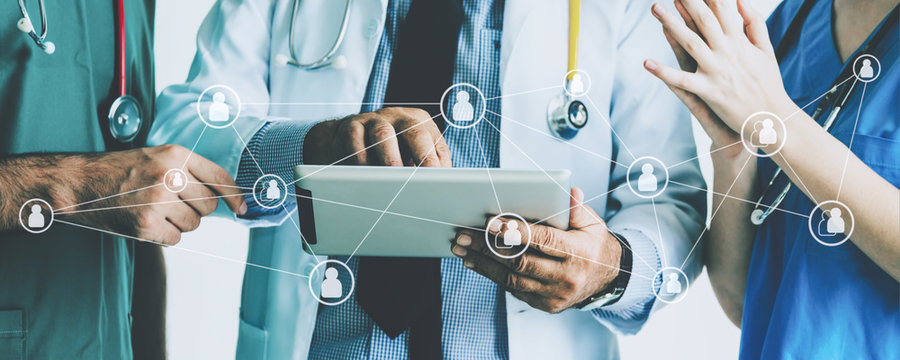 Group of doctor with tablet and graphic network