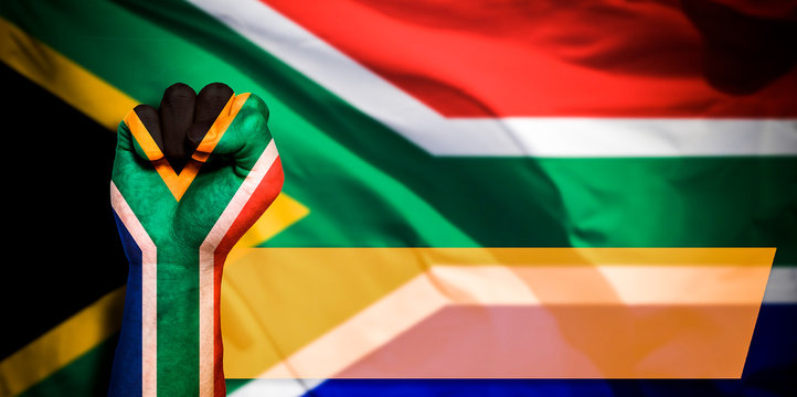 Banner of Flag of South Africa painted on male fist, fist flag, country of South Africa, strength, power, concept of conflict. On a blurred background
