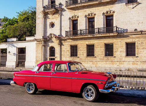 Vintage Car in front of the San Carlos and San Ambrosio Seminary, La Habana Vieja, Havana, La Habana Province, Cuba