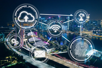 Smart city, wireless technology abstract on Singapore financial district background at night