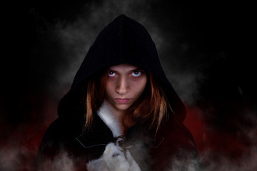 Young scary woman with black hood