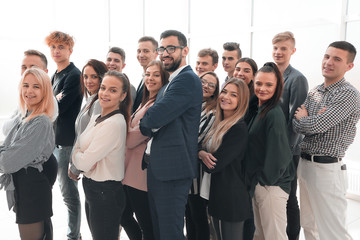 Fototapeta group of diverse young people standing together and looking ahead