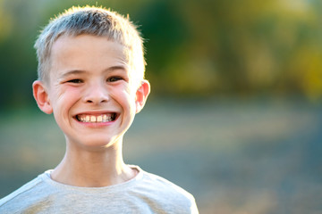 Portrait of a child boy outdoors on a warm sunny summer day. Fotomurales