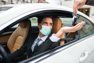 Masked man taking the car keys