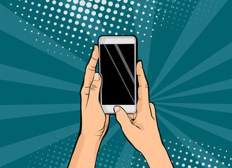Hands holding smartphone pop art.Hands hold a mobile phone. Vector illustration in comic style.