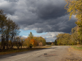 Printed kitchen splashbacks Autumn Empty road in Chernobyl Exclusion Zone. Dramatic sky.