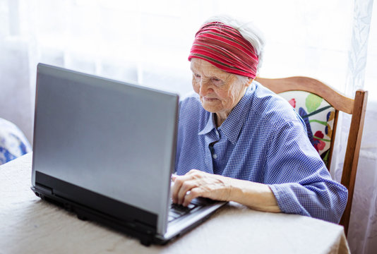Senior woman using laptop computer at home