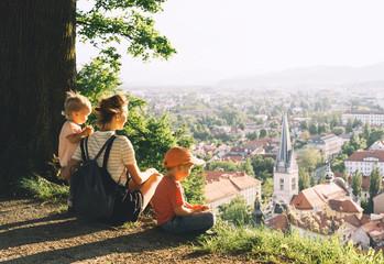 Family outdoors on background of Ljubljana, Slovenia, Europe. Wall mural