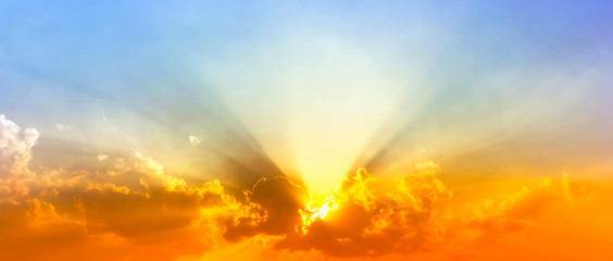 Fototapeta colorful sunshine light in blue sky with clouds and bright red orange and yellow color light