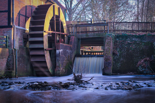 Water Wheel By Waterfall