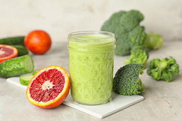 Fotobehang - Glass of healthy smoothie and ingredients on table